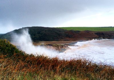 Winter spume over cliffs