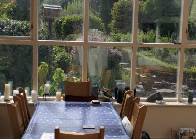 The conservatory and breakfast table.